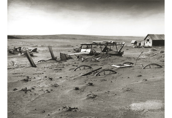 Buried machinery in barn lot. Dallas, South Dakota, 1936