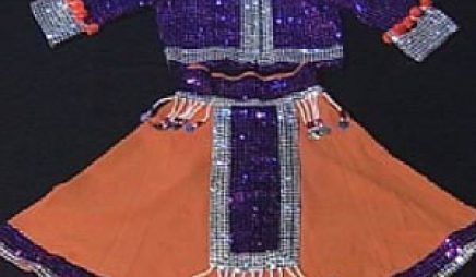 Ceremonial Skirt / Blouse: Ga'Amay The colorful blouse is believed to be a ceremonial article of clothing that the religious leader of the Ga'Amayans would probably wear during religious ceremonies. Its intricate designs and patterns led archaeologists to believe that the Ga'Amayans had marvelous craftsmanship, because they probably had to make everything that has been embellished on the blouse. The Ga'Amayans were probably very skilled at making metal flat and workable, so they must have had metal deposits on their island, because they use it in their clothing. Media: silver beads, cloth, purple beads Size: 30cm x 71.5 cm